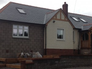 Calidad slate on the roof with red ridge tiles alternative angle