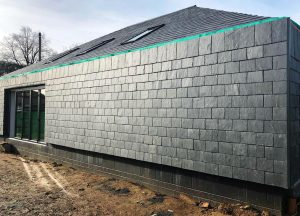 Calidad 10 natural slate cladding on the facade